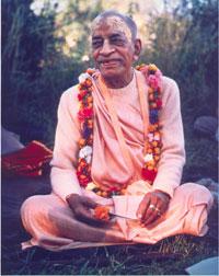 Prabhupada smiling with flower